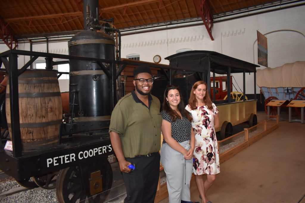 Three Northeast Maglev interns pose in front of the B&O Railroad Museum in Baltimore, Maryland