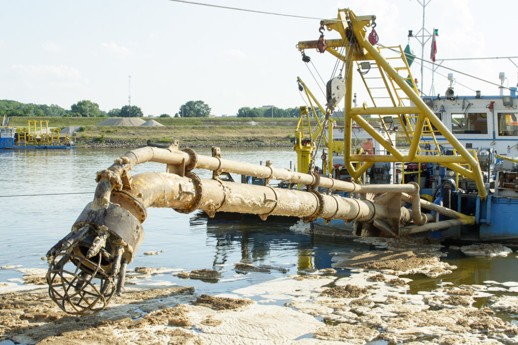Color photo of suction dredge in muddy conditions
