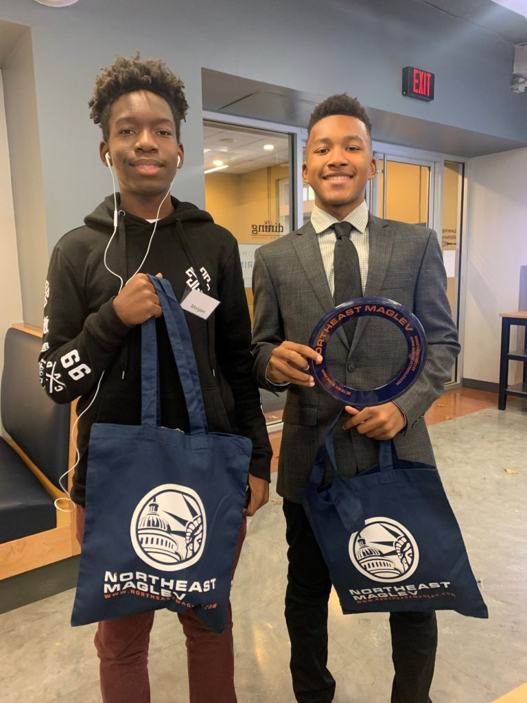 Two young men with Northeast Maglev goodies at Greater Baltimore Urban League's Saturday Leadership Program