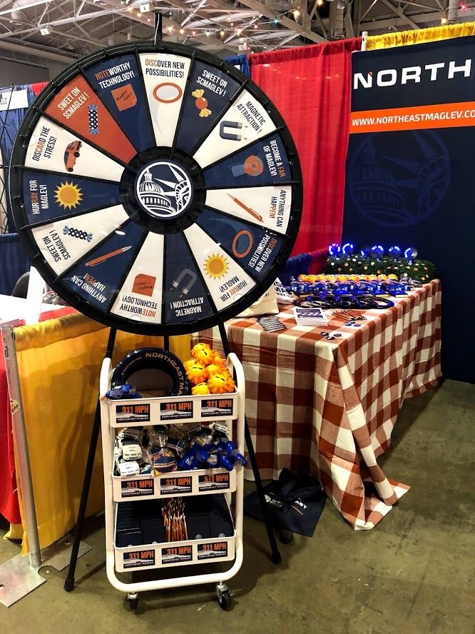 Northeast Maglev prize wheel and table at the Maryland Association of Counties Summer 2019 Conference