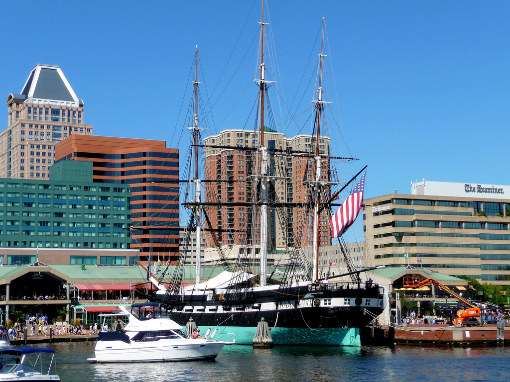 Naval warship USS Constellation at Baltimore's Inner Harbor on a sunny day