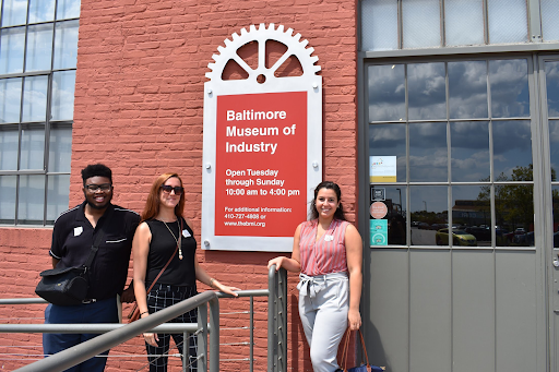 Three Northeast Maglev interns pose in front of the Museum of Industry in Baltimore, Maryland