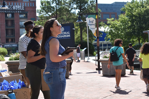 Focused photo of Northeast Maglev interns canvassing Baltimore's Inner Harbor