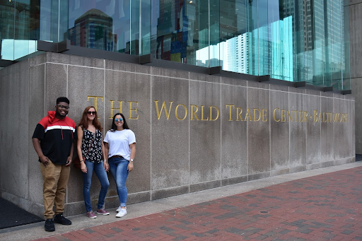 Three Northeast Maglev interns pose in front of the World Trade Center in Baltimore, Maryland