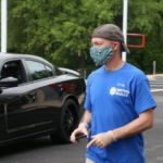 Northeast Maglev employee in facemask helping to distribute Covid-19 facemasks in Prince George's County, Maryland
