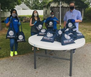Photograph of Northeast Maglev employees at a face mask distribution event