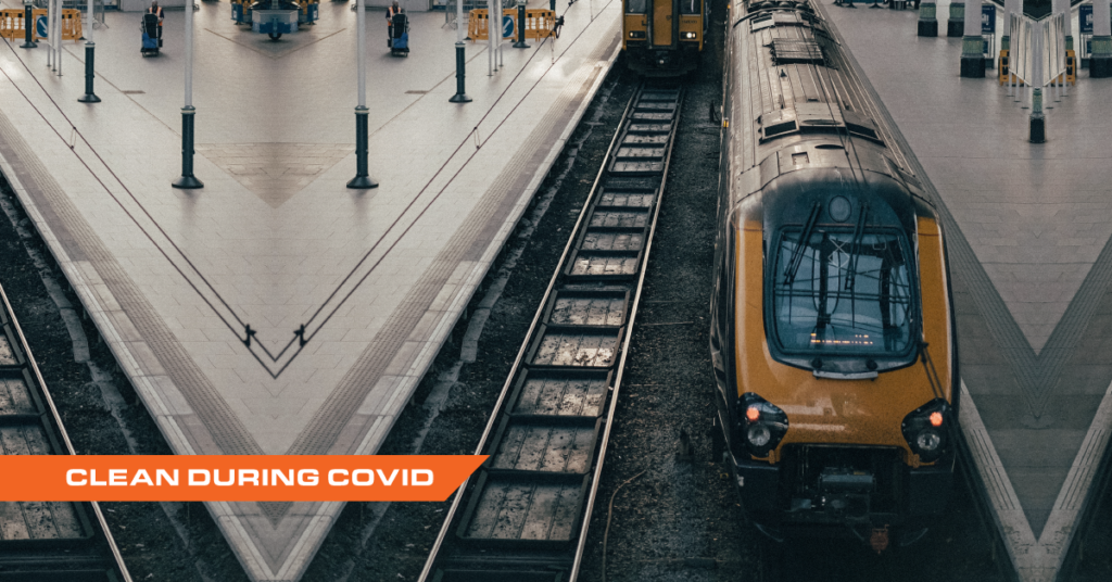 Photograph of empty train station with title Clean During Covid