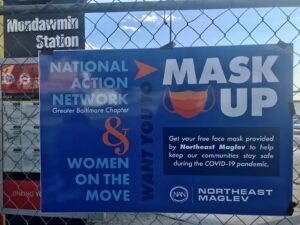 Photograph of poster advertising the National Action Network Mask Up event sponsored by Northeast Maglev