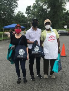 Photograph of Northeast Maglev employees at a COVID mask distribution event